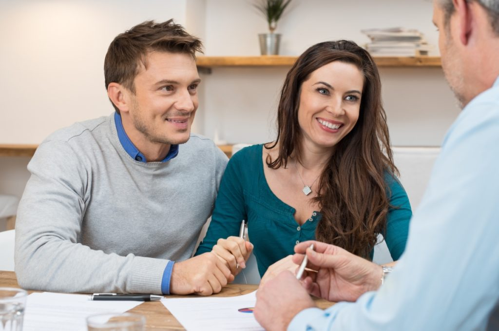 Loan officer explains to couple what a pre-approval is and why they need one